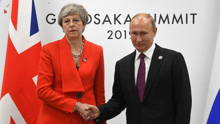 普京与梅在G20大阪峰会期间会面图源:路透社