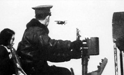 """北京五号""""试飞时,飞行员在地面调试,操控无人机翱翔天空。"""